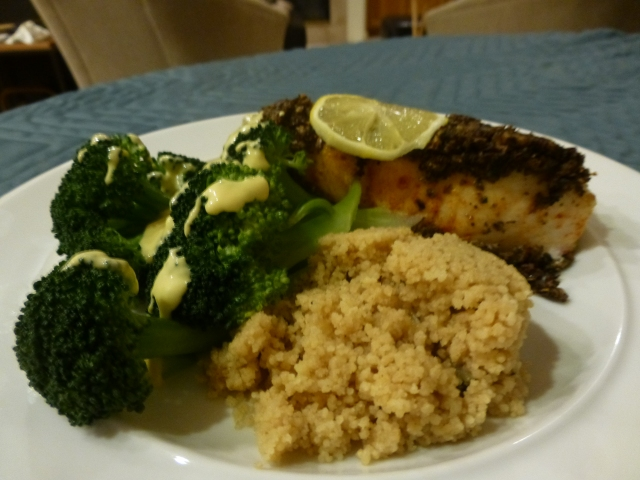 Chilean sea bass with mushroom topping, couscous, and broccoli with mustard sauce