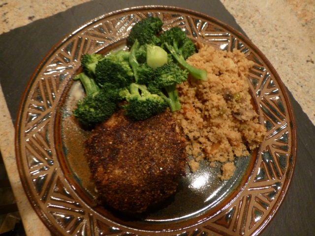 Chicken breast with a dukkah coating accompanied by whole wheat couscous with aromatic vegetables and steamed broccoli