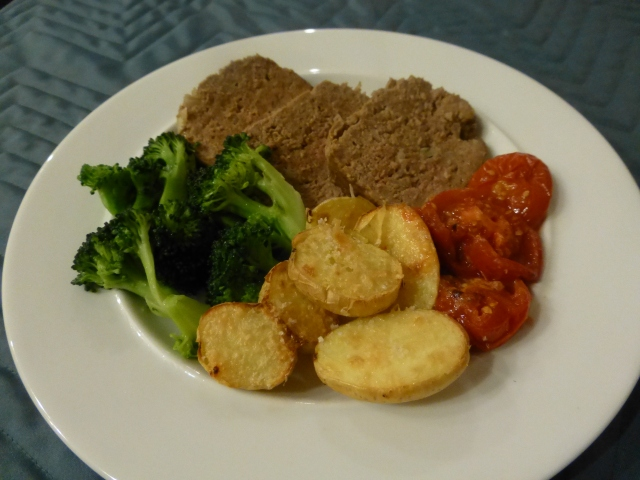 Meatloaf with roasted potatoes and tomatoes, steamed broccoli