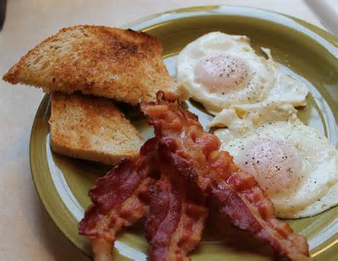 My breakfast looks something like this except with one egg, one piece of toast, two strips of bacon and a lot of home fries.