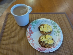 One egg scrambled on a light multi-grain English muffin and a cup of tea