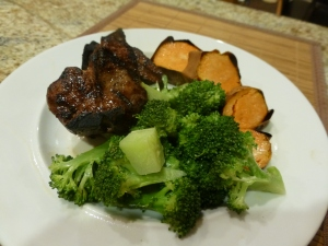 Grilled lamb chops, roasted sweet potato, and steamed broccoli