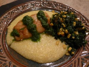 Roasted cod with parsley sauce over soft polenta with collard greens and corn