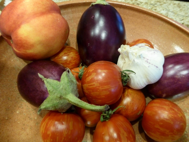 Our produce from the farmer's market - Indian eggplant, tiger tomatoes, garlic, and a nectarine