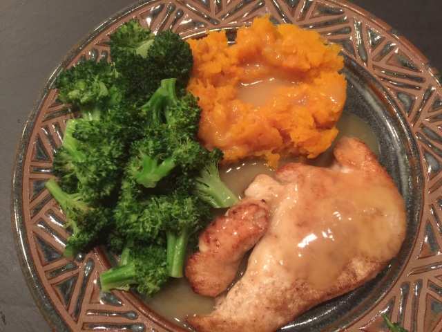 Pan-roasted chicken breast with butternut squash, broccoli, and gravy