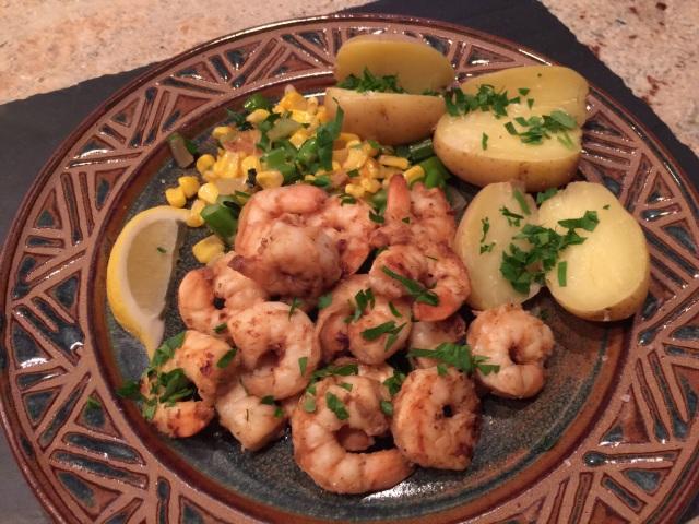 Shrimp on succotash with new potatoes