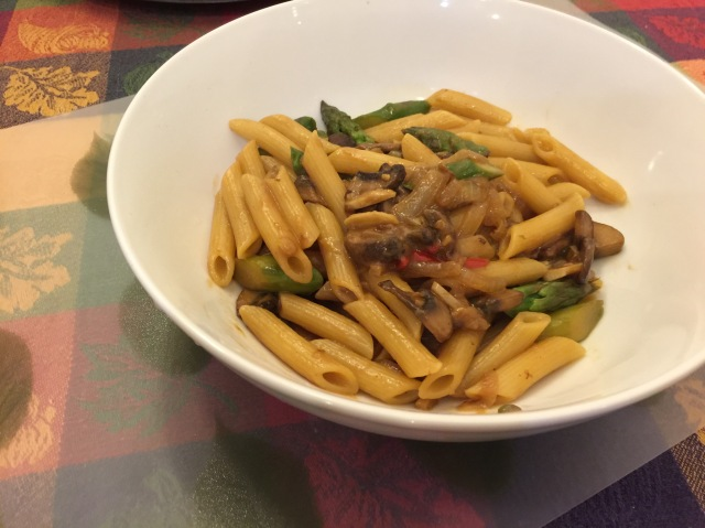 Penne with asparagus and mushrooms in a peanut sauce