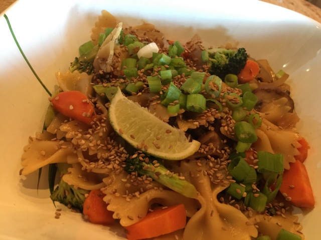 Farfalle and vegetables in peanut sauce