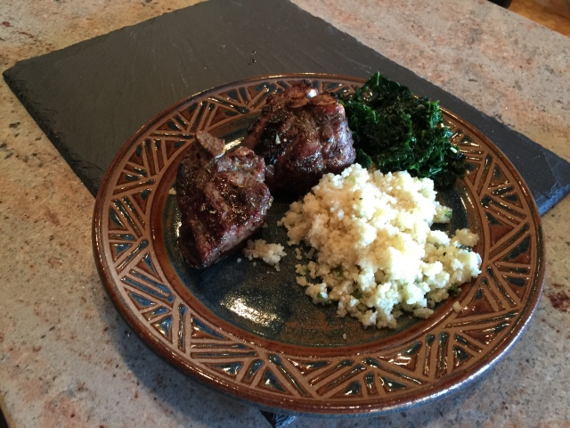 Grilled lamb chops with couscous and kale