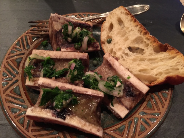 Roasted marrow bones with parsley, onions, and garlic and a crusty piece of bread