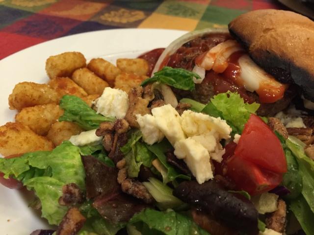 Grilled hamburger, garden salad and tater tots