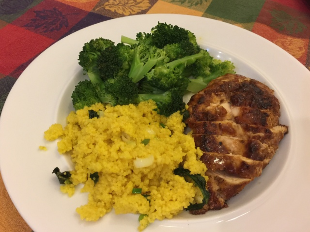 BBQ glazed chicken breast, lemon-garlic couscous, and screamed broccoli