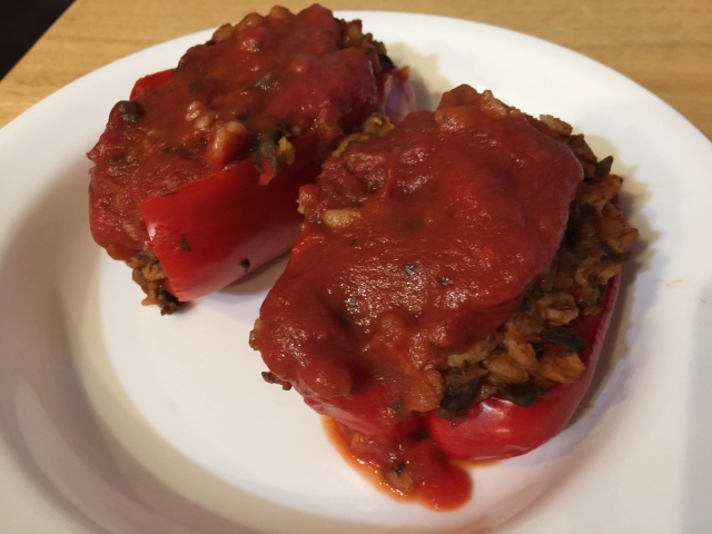 Red bell peppers stuffed with farro and mushrooms
