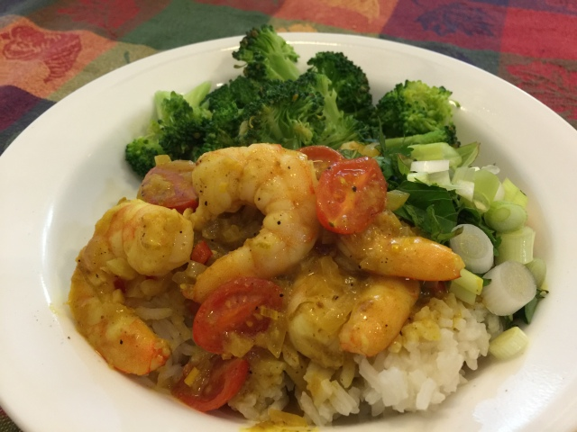 Curried shrimp with cherry tomatoes and rice
