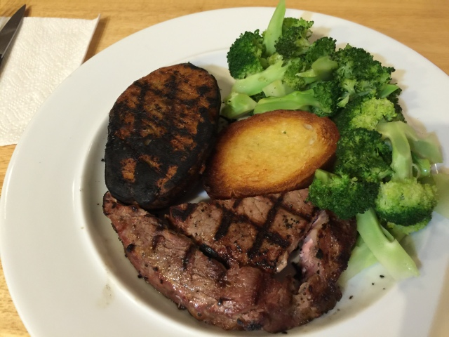 Grilled ribeye with broccoli and grilled potato