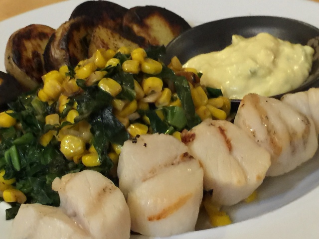 Grilled scallops with new potatoes and collards and corn