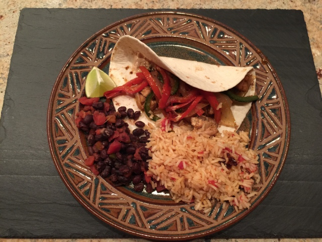 Chicken fajitas with spicy black beans and Mexican rice