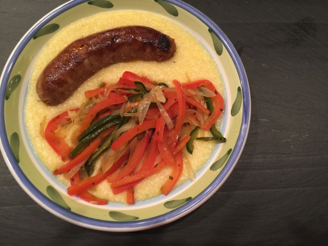 Sausage with peppers and onions over polenta