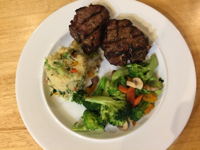 Lamb chops, couscous, and broccoli