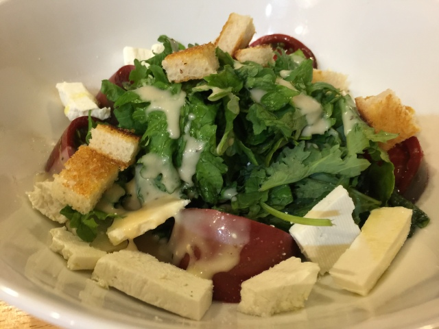 Kale salad with croutons and ricotta salata