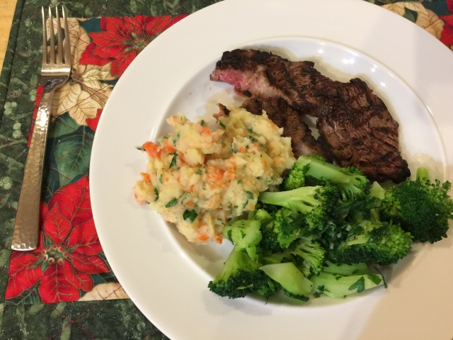 Grilled ribeye steak with confetti mashed potatoes and broccoli