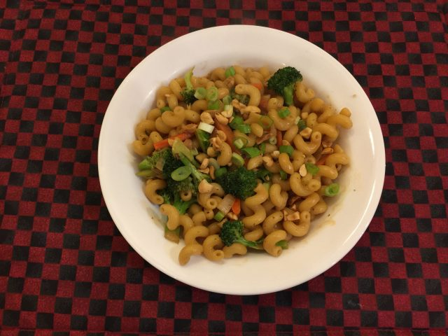 Cellentani with broccoli and carrots in peanut sauce