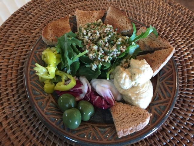 Hummus, tabbouleh, salad, toast points, olives, and pepperoncini