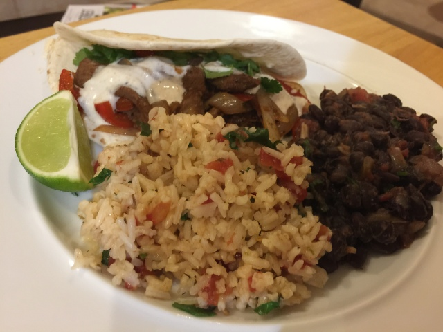 Steak fajitas, black beans, and rice