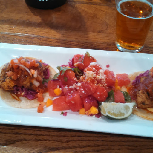 Mahi mahi fish tacos with watermelon salad
