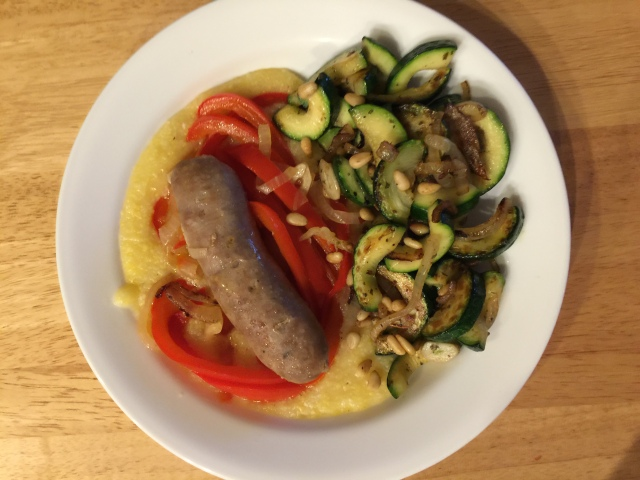 Polenta with sweet Italian sausage plus a side of sautéed zucchini