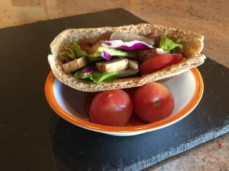 Whole wheat pita stuffed with tomato, lettuce and tofu